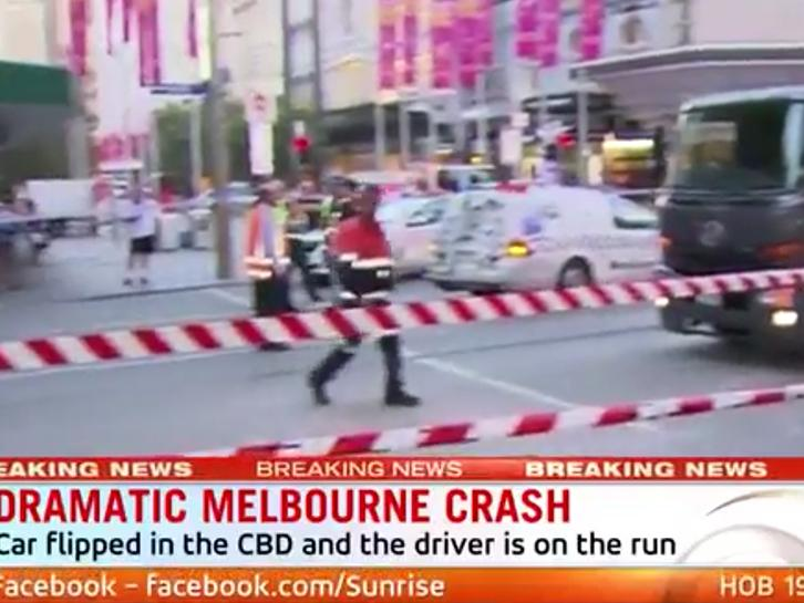 Driver on the run after dramatic crash on Bourke Street